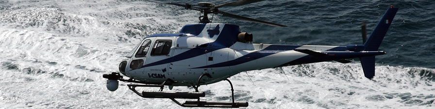 AS 350 Helicopter fitted with gyro stabilised camera system at work over the Mediterranean